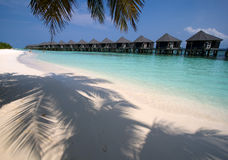 Bungalows on a tropical island. Resort with white sand Stock Photos