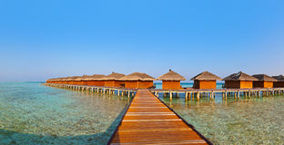Bungalows on tropical Maldives island Stock Images