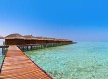 Bungalows on tropical Maldives island Stock Photo