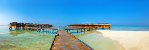 Bungalows on tropical Maldives island Stock Photography