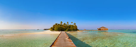 Bungalows on tropical Maldives island Stock Photo