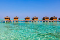 Bungalows on tropical Maldives island Royalty Free Stock Images