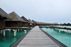 Bungalows on the water in Maldives Stock Photo
