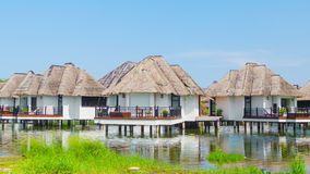 Bungalows on the water's edge. Tranquil place to stay. stock video