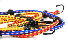 Bungee cords. Stock pictures of bungee cords with steel hooks of several colors stock photos