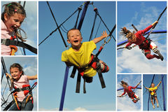 Bungee jumping. Little children  jumping on the trampoline (bungee jumping Royalty Free Stock Image