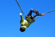 Bungee jumping. Girl in bungee ropes in the air Stock Photography