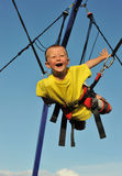 Bungee jumping. Little boy  jumping on the trampoline (bungee jumping Stock Images