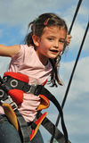 Bungee jumping. Little girl jumping on the trampoline (bungee jumping Stock Photo