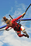 Bungee jumping. Young teenager jumping on the trampoline (bungee jumping Royalty Free Stock Image