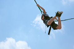 Bungee Jumping Boy Against Sky with Clipping Path Stock Images