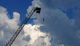 Bungee jumping from a crane stock photos
