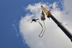Bungee jumping. A view of a person bungee jumping from a crane Royalty Free Stock Photos