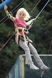 Bungee. Young girl have fun with jumping bungee Stock Image