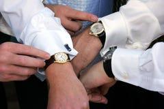 Buninessmen checking time Royalty Free Stock Photos