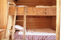 Bunk beds. View of  typical bedroom with wood bunk beds Stock Photos