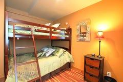 Bunk beds in bedroom Stock Images