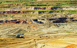 Bunk wall surface mine with exposed colored minerals and brown coal Stock Photo