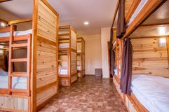 Bunk wooden beds in the hostel. Personal lighting over each bed. royalty free stock photos