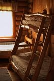 Bunk wooden beds in a hostel wooden room stock images