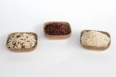 3 bunkar av rå ris Arkivbilder