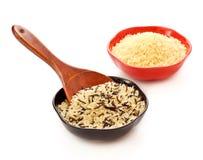 Bunkar av rå ris Arkivfoton