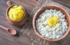 Bunkar av ris och Ghee klargjort smör Royaltyfria Bilder