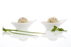 bunkar breder smör på växt- två arkivfoton