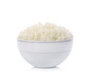 Bunke av ris på vit bakgrund Fotografering för Bildbyråer