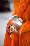 Bunke för allmosa för munk` s Arkivfoton
