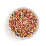 Bunken med färgrikt socker strilar prickar garnering för kaka och bakelse Top beskådar Isolerat på vit royaltyfria foton