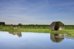 Bunker along the water. Concrete bunkers along a ditch at Sleeuwijk in the Dutch province of Noord-Brabant Stock Image