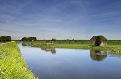 Bunker along the water. Concrete bunkers along a ditch at Sleeuwijk in the Dutch province of Noord-Brabant Stock Photo