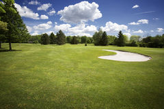Bunker on golf course and cloudy sky stock photos