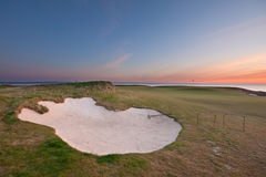 Bunker on a golf course at sunrise Stock Image