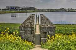 Bunker, lake and motorway. Culemborg, The Netherlands, April 8, 2018: View from the towards the sawed through bunker 599, with the adjacent lake and the A2 stock photo