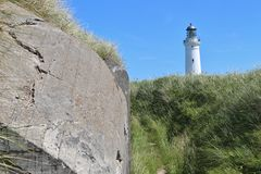 Bunker and lighthouse, North Denmark, Europe. Stock Photography