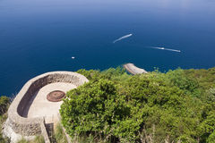 Bunker over the sea. Second world war bunker stands between arbutus tree over Mediterranean sea in Liguria, Italy Royalty Free Stock Photo
