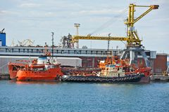 Bunker ship (fuel replenishment tanker) under port crane Stock Images