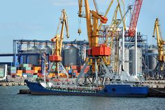 Bunker ship (fuel replenishment tanker) under port crane Stock Photography