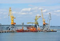 Bunker ship (fuel replenishment tanker) under port crane Royalty Free Stock Image