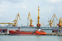 Bunker ship (fuel replenishment tanker) under port crane Royalty Free Stock Photo