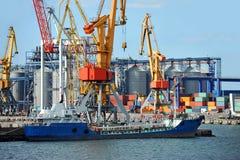 Bunker ship (fuel replenishment tanker) under port crane Royalty Free Stock Images