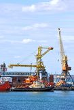 Bunker ship and tugboat under port crane Royalty Free Stock Photo