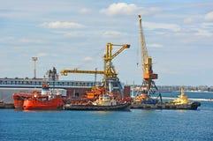 Bunker ship under port crane Stock Photography