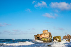 Bunker on shore of the Baltic Sea on a stormy day Royalty Free Stock Photography