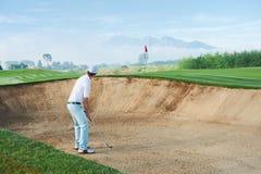 Bunker shot. Golf shot from sand bunker golfer hitting ball from hazard Royalty Free Stock Photos