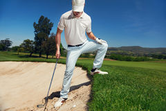 Bunker shot. Golf shot from sand bunker golfer hitting ball from hazard Royalty Free Stock Images