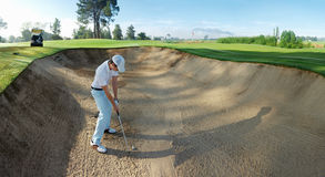 Bunker shot. Golf shot from sand bunker golfer hitting ball from hazard stock images