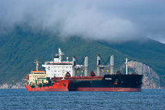Bunkering tanker Langeri balker Spar Mira. Nakhodka Bay. East (Japan) Sea. 22.07.2015 Royalty Free Stock Photos